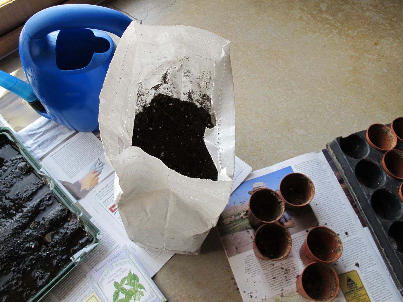 Organic seed-starting soil, pots, and the flat with its water-wicking mat to help the pots stay moist.