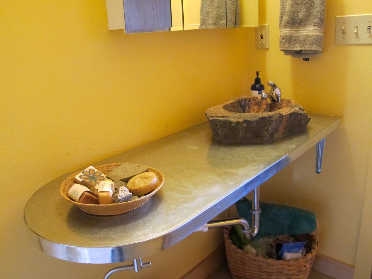 Guest bathroom counter with its new galvanized edging and the beautiful Richard-carved basin.