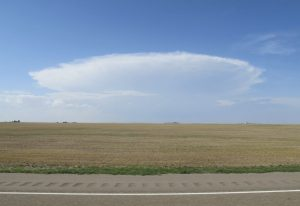 The Oklahoma Panhandle, between Guymon and Boise City, a landscape that brings new meaning to the word 'level.'