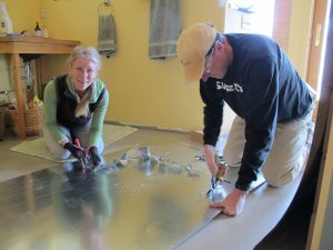 Tony, teaching me how to cut a window-opening in a sheet of galvanized steel that's about to morph into paneling for a tub-shower surround.
