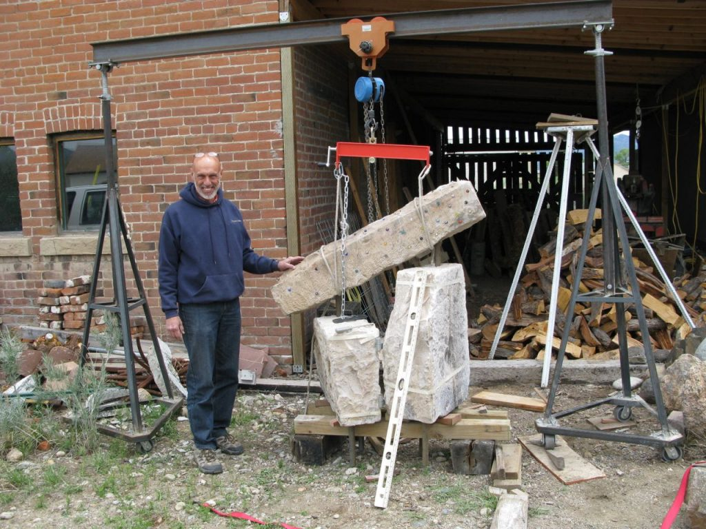 """Richard with """"Matriculation,"""" ready to load it on a trailer to install in the Steamplant Sculpture Garden"""