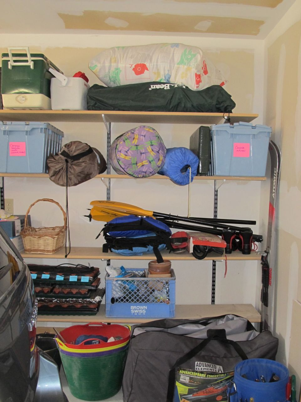 Tidy shelves of camping gear (above) and garden stuff (below).