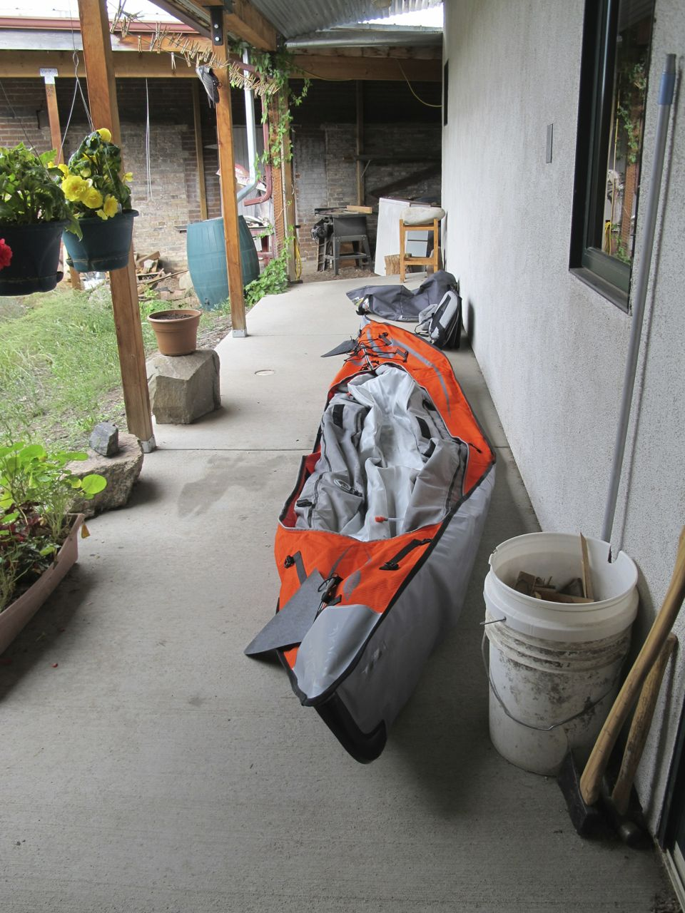The deflated kayak, drying on the back porch.