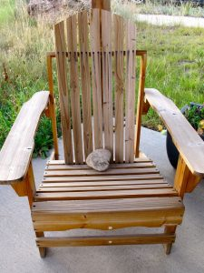 Adirondack chair on the guest cottage porch. (The rock is a weight.)