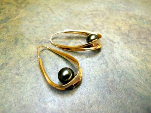 Scavezze Studio earrings, gold curves so light they float, with Tahitian black pearls