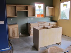 The kitchen area with cabinets in, before Mackee began building sills and putting up window trim.