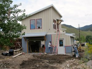 The stucco crew applies color to Treehouse.