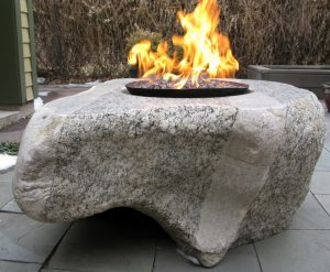 """Paula's Find,"" a one-ton granite and steel firepit Richard sculpted."