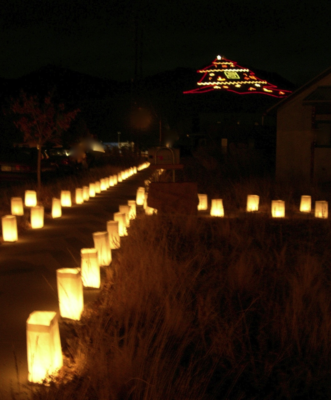 Luminarias line the sidewalk with Salida's Christmas Mountain in the background.