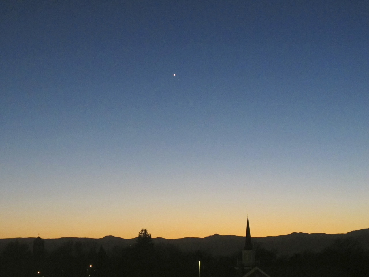 Venus pierces/ deep blue evening sky/ steeples point in awe