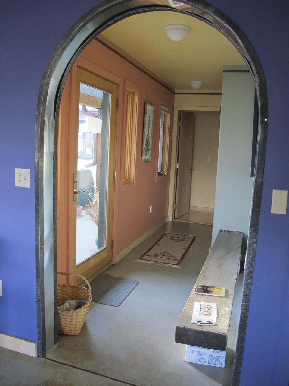 Curving steel arches trim the living room doorway in Terraphilia, my old house.
