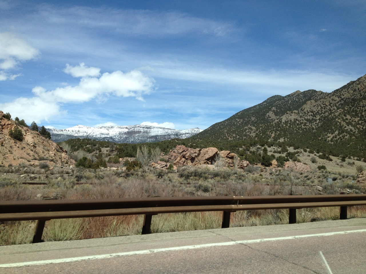 Spring snow on the high mesas above the river canyon.