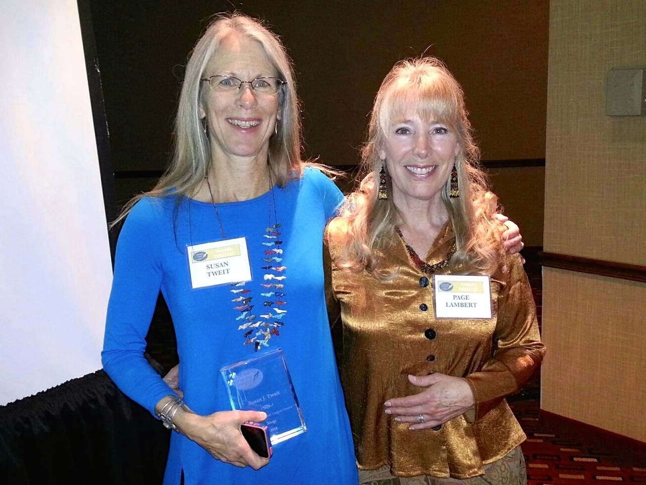 """With friend and fellow author, Page Lambert, holding my crystal """"book"""" after the banquet. Photo: John Gritts"""