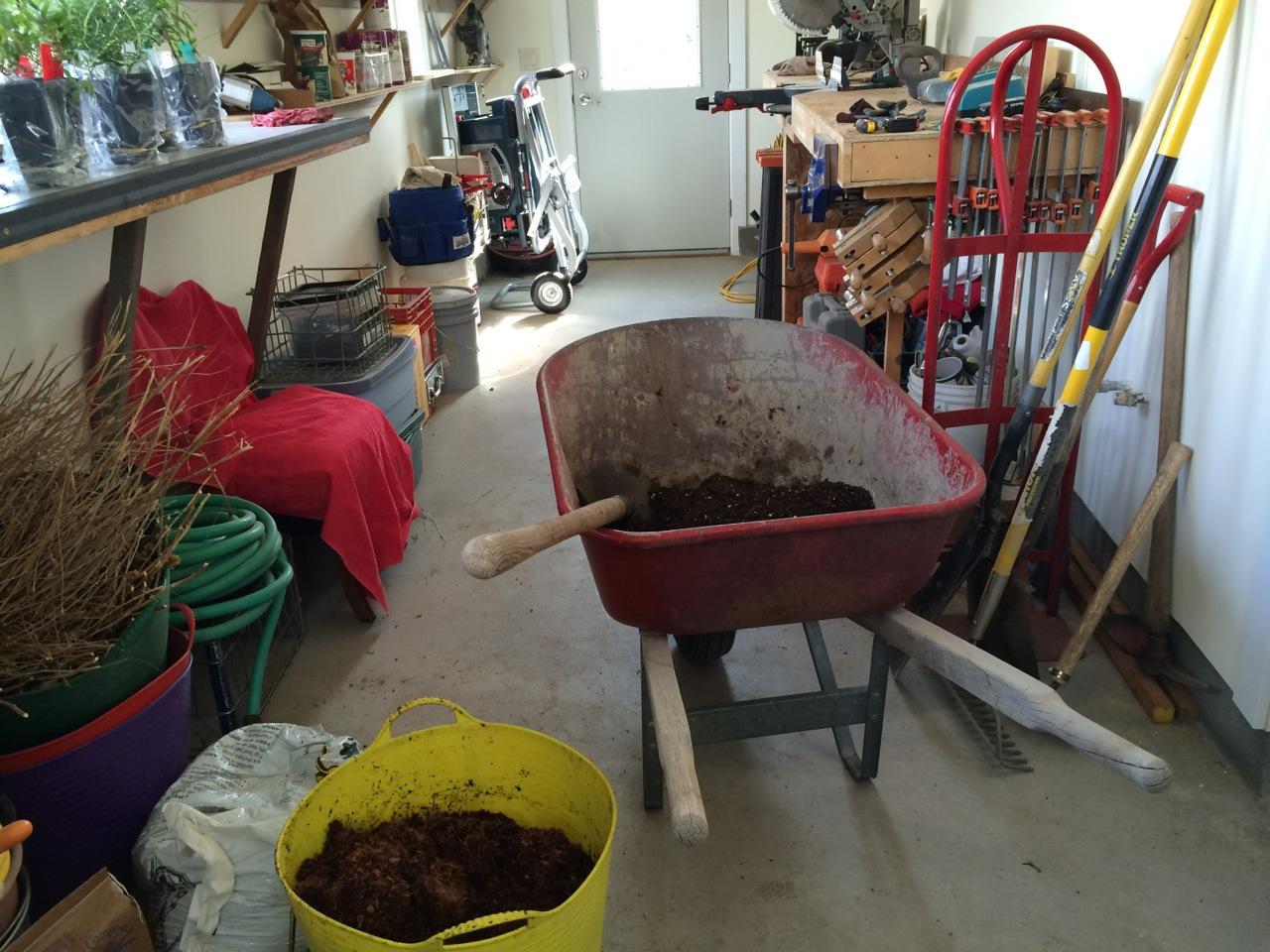 Mixing soil in the wheelbarrow in my sunny workshop.