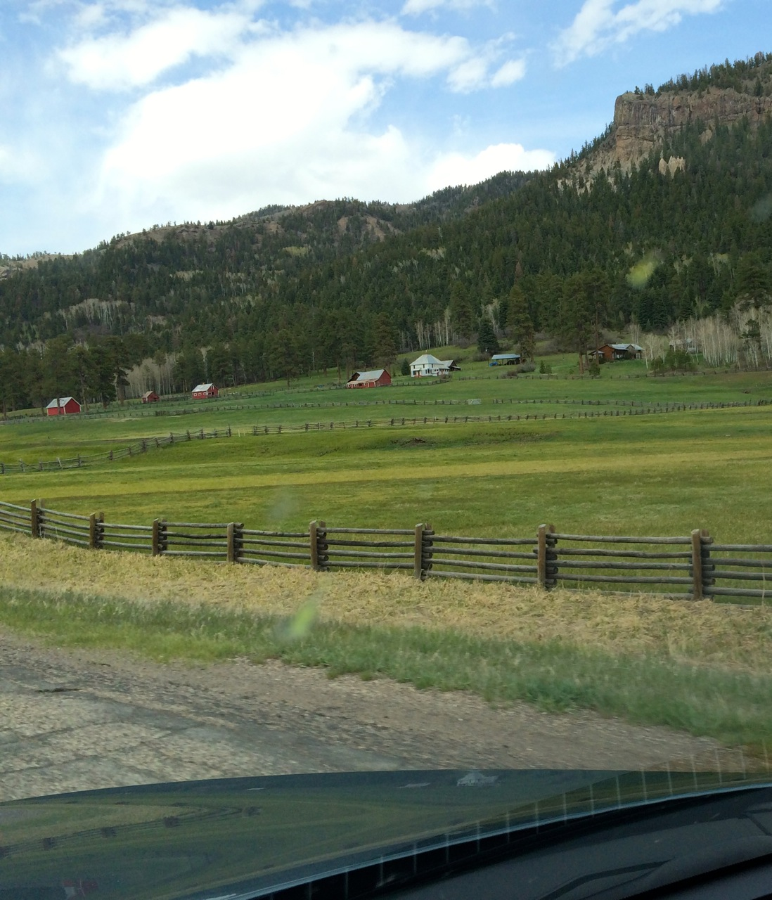 Historic ranch above Pagosa Springs. Not the pattern: meadows in the valley bottom on glacial soil, forest on the volcanic layers of the mountainsides.