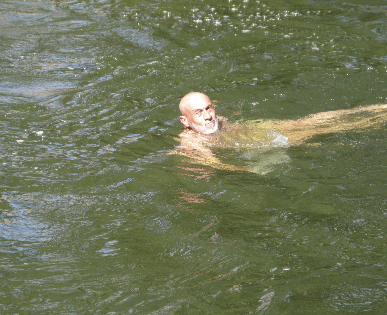 Richard swimming in the Arkansas River on his 60th birthday (after brain surgery one, a month before brain surgery two).