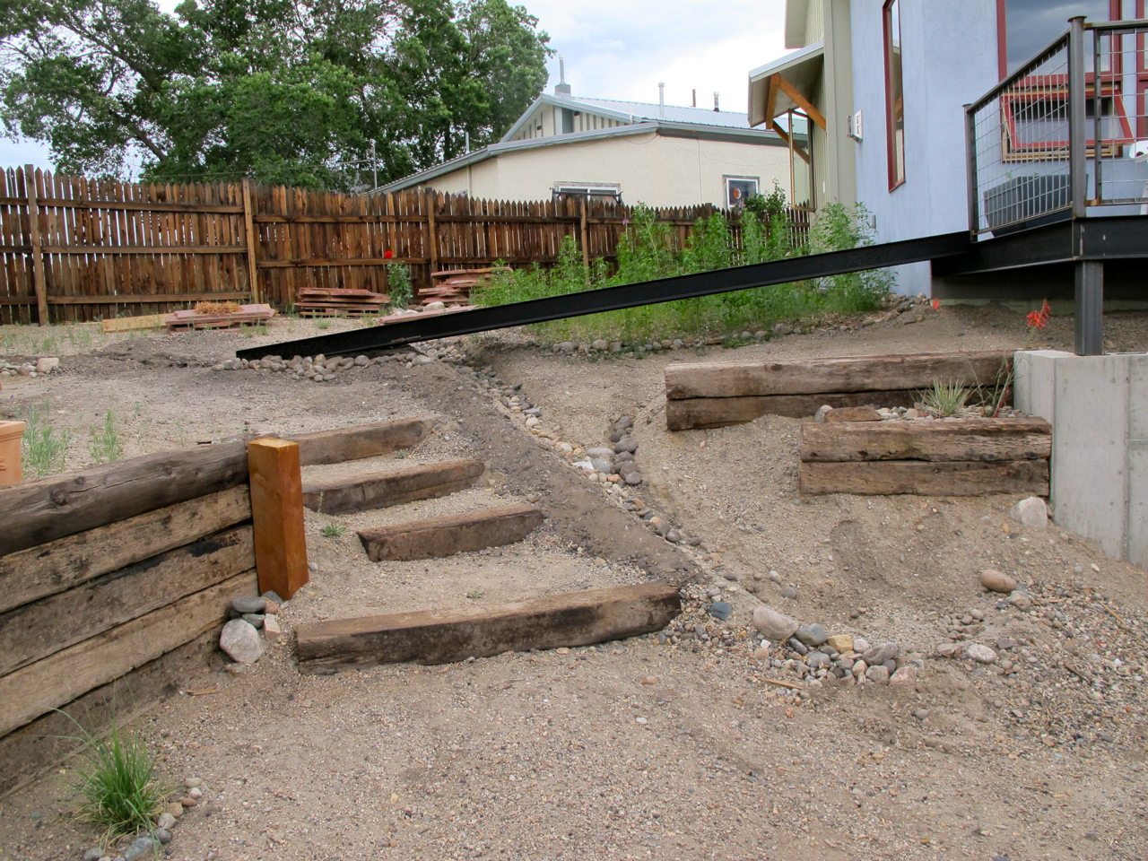 The steps, slope, and main dry creek channel; the new tributary comes in from the left of the wheelchair ramp.