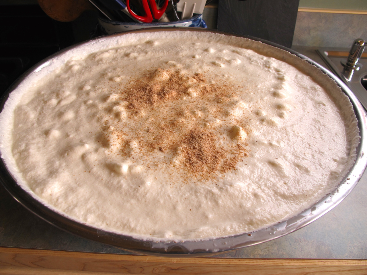 A double recipe of finished eggnog in Richard's largest bread-dough bowl